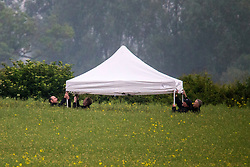 © Licensed to London News Pictures. 30/05/2018. Aldborough, UK. Picture shows police forensic officers at the scene of a helicopter crash in Aldborough north Yorkshire. Emergency services attend the scene of a helicopter crash near the village of Aldborough. Photo credit: Andrew McCaren/LNP