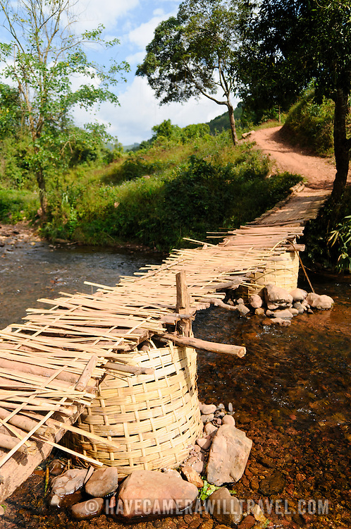A bamboo bridge crossing a small creek leading to Lakkhamma Village in Luang Namtha province in northern Laos. Lakkhamma Village was established as a joint project between the Lao government and the European Commission.