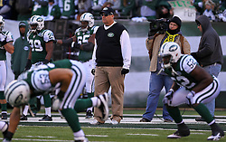 Dec 24, 2011; East Rutherford, NJ, USA; Head coach Rex Ryan watches his team warm up before the first half of their game against the New York Giants at MetLife Stadium.