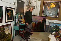 Painter Dennis Morton in his studio space located within the Imagine Gallery on Beacon Street West in downtown Laconia.  (Karen Bobotas/for the Laconia Daily Sun)