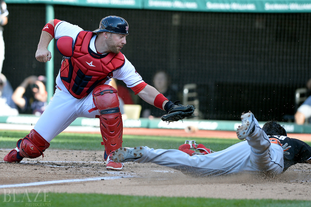 Sep 4, 2016; Cleveland, OH, USA; Miami Marlins second baseman Derek Dietrich (32) slides safely into home as Cleveland Indians catcher Chris Gimenez (38) is late with the tag during the third inning at Progressive Field. Mandatory Credit: Ken Blaze-USA TODAY Sports