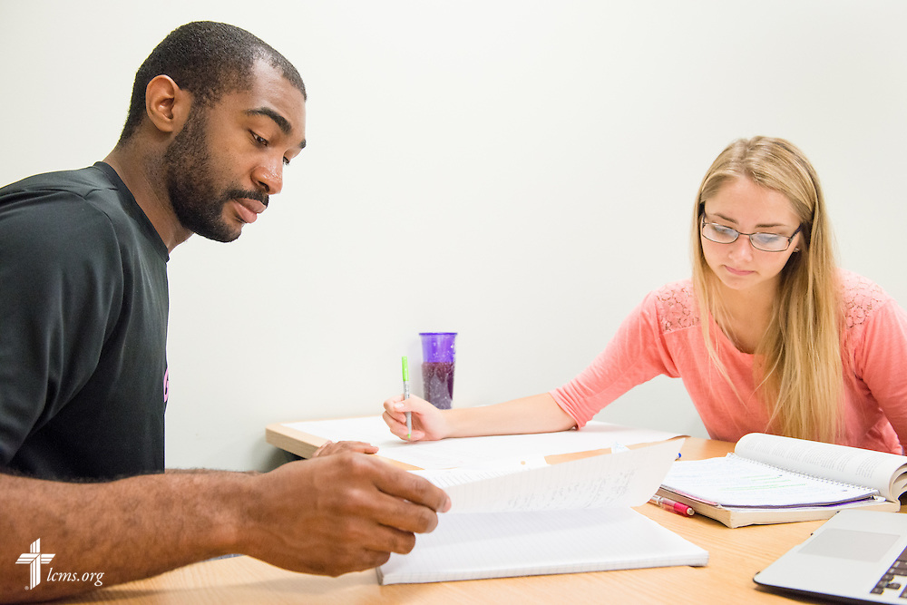 Joshua Williams and Samantha Graf work together during a class at Concordia University Texas on Wednesday, July 16, 2014, in Austin, Texas. LCMS Communications/Erik M. Lunsford