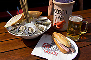 Sylt, Germany.<br /> 50 Years of Gosch fish restaurant. World's best Matjes sandwich, Sylter Royal oysters and a portrait of founder Jürgen Gosch on a napkin.