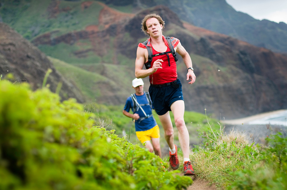 Justin Tade and Brendan Mchugh on the return leg of a 23 mile out-n-back run along the Kalalau Trail.  Na Pali Coast, Kauai, HI.