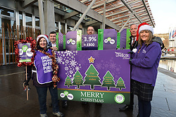 Pictured: Tom Waterson, Laura McDonald, Watty Gaffney, George Frame and Lillian Macer from UNISON with a giant Christmas card and cracker demanding fair pay for NHS workers.<br /> <br /> UNISON delivers 5000 'Fair Pay Now' cards to MSP's at the Scottish Parliament, demanding the Scottish Government 'pays up on NHS pay'.<br /> <br /> &copy; Dave Johnston/ EEm