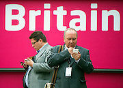 © Licensed to London News Pictures. 23/09/2014. Manchester, UK. People use their mobile phones.  Labour Party Conference 2014 at the Manchester Convention Centre today 23 September 2014. Photo credit : Stephen Simpson/LNP