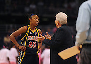 Aug 8, 2010; Phoenix, AZ, USA; Indiana Fever guard Briann January speaks with head coach Lin Dunn during the first half at US Airways Center.  The Fever defeated the Mercury 104-82.  Mandatory Credit: Jennifer Stewart-US PRESSWIRE