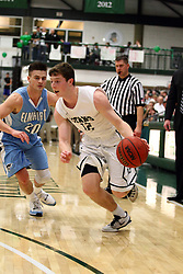 20 February 2016:  Kyle Wuest trails Joel Pennington(12) at the 3 point arc during an NCAA men's division 3 CCIW basketball game between the Elmhurst Bluejays and the Illinois Wesleyan Titans in Shirk Center, Bloomington IL