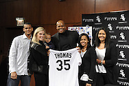 CHICAGO - FEBRUARY 12:  Former Chicago White Sox first baseman and designated hitter Frank Thomas #35 holds up his soon to be retired uniform number with his family, L-R, son Sterling , wife Meghan, son Frank Jr., and daughters Sydney and Sloan during a press conference to announce his retirement from Major League baseball on February 12, 2010 at U.S. Cellular Field in Chicago, Illinois.  Thomas played 16 years for the White Sox, from 1990 to 2005.  (Photo by Ron Vesely)