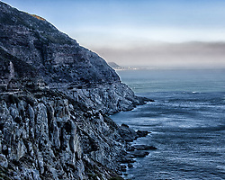 March 18, 2011 - Western Cape, South Africa - A spectacular road, known as Chapman's Peak Drive, hugs the near-vertical face of Chapman's Peak on Hout Bay on the Atlantic Seaboard of South Africa's Cape Peninsula. Hacked out of the mountain's face the road, with its scenic views, is a major feat of engineering. (Credit Image: © Arnold Drapkin/ZUMAPRESS.com)