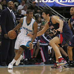 05 November 2008:  New Orleans Hornets guard Chris Paul (3) is defended by Atlanta Hawks center Zaza Pachulia (27) during the first half of a NBA game between the New Orleans Hornets and the Atlanta Hawks at the New Orleans Arena in New Orleans, LA..
