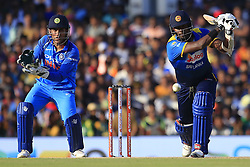 August 20, 2017 - Dambulla, Sri Lanka - Sri Lankan cricketer Angelo Mathews (R) plays a shot as India's MS Dhoni looks on during the 1st One Day International cricket match bewtween Sri Lanka and India at Dambulla International cricket stadium situated in the Central Province and the first and only International cricket ground in the dry zone of Sri Lanka on Sunday 20 August 2017. (Credit Image: © Tharaka Basnayaka/NurPhoto via ZUMA Press)