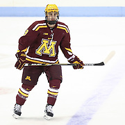 Ryan Reilly #9 of the Minnesota Gophers warms up on the ice prior to the game against the Northeastern Huskies at Matthews Arena on November 29, 2014 in Boston, Massachusetts. (Photo by Elan Kawesch)