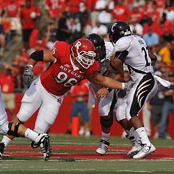 Sep 7, 2009; Piscataway, NJ, USA; Rutgers defensive tackle Charlie Noonan (96) misses a tackle on Cincinnati running back Isaiah Pead (23) during the first half of Rutgers game against Cincinnati in NCAA college football at Rutgers Stadium.