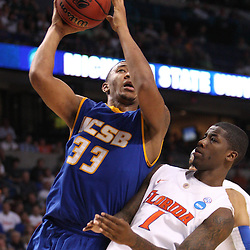 Mar 17, 2011; Tampa, FL, USA; UC Santa Barbara Gauchos guard/forward Orlando Johnson (33) shoots over Florida Gators guard Kenny Boynton (1) during second half of the second round of the 2011 NCAA men's basketball tournament at the St. Pete Times Forum. Florida defeated UCSB 79-51.  Mandatory Credit: Derick E. Hingle