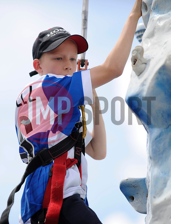 A boy climbs the everest challenge at the fun day - Photo mandatory by-line: Dougie Allward/JMP - Mobile: 07966 386802 27/07/2014 - SPORT - FOOTBALL - Bristol - Bristol Rovers - - Memorial Stadium - Fun Day
