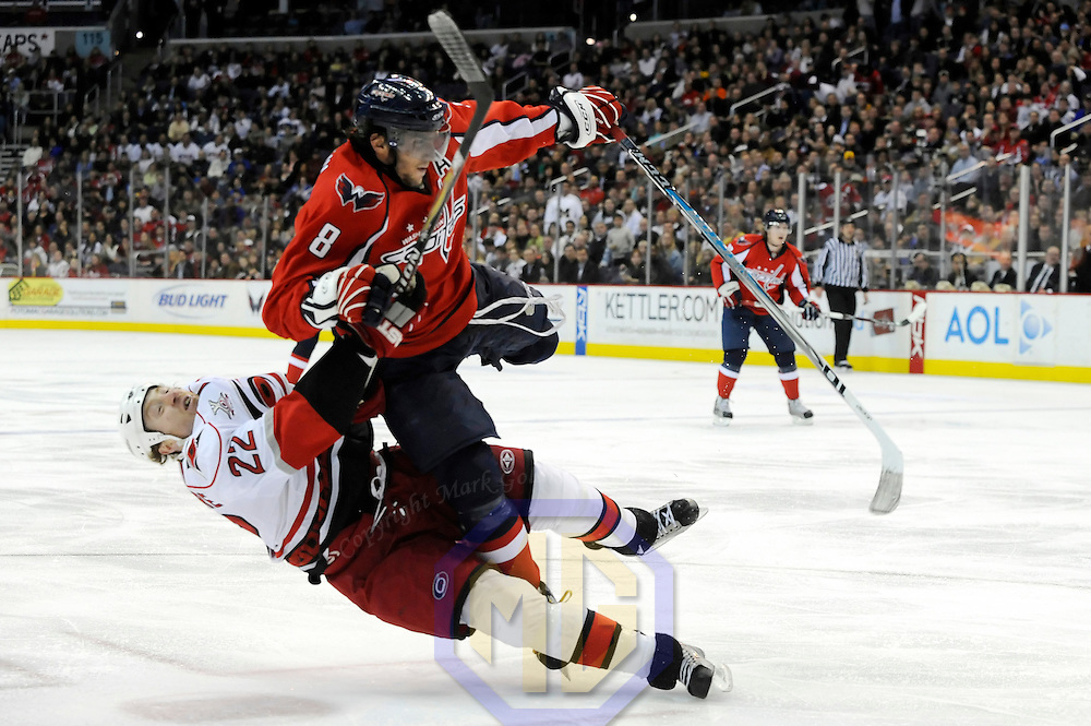 08 February 2008:  Carolina Hurricanes defenseman Mike Commodore (22) is taken down after attempting a shot in the second period by Washington Capitals left wing Alexander Ovechkin (8) who is pulled down to the ice at the Verizon Center in Washington, D.C.  The Hurricanes defeated the Capitals  2-1.