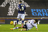Shaun Williams of Millwall is tackled by Lee Chung-Yong of Bolton Wanderers during the Sky Bet Championship match at The Den, London<br /> Picture by David Horn/Focus Images Ltd +44 7545 970036<br /> 19/12/2014