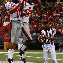 Sep 11, 2010; New Orleans, LA, USA; Mississippi Rebels wide receiver Markeith Summers (16) celebrates with teammate wide receiver Ja-Mes Logan (85) after scoring a touchdown against the Tulane Green Wave during the first half at the Louisiana Superdome.  Mandatory Credit: Derick E. Hingle