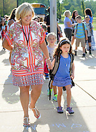 Guidance Counselor Judy Schuster walks to classes with Riley Wiend on the first day of classes at West Rockhill Elementary School Monday August 29, 2016 in West Rockhill Township, Pennsylvania.  (Photo by William Thomas Cain)