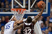 UK forward Willie Cauley-Stein, left, contest a shot by Mississippi State guard Craig Sword in the first half. The University of Kentucky Men's Basketball team hosted Mississippi State , Wednesday, Feb. 27, 2013 at Rupp Arena in Lexington .