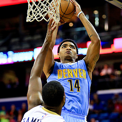 Mar 31, 2016; New Orleans, LA, USA; Denver Nuggets guard Gary Harris (14) shoots over New Orleans Pelicans guard Jordan Hamilton (25) during the first quarter of a game at the Smoothie King Center. Mandatory Credit: Derick E. Hingle-USA TODAY Sports