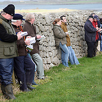 Racing punters take shelter from the cold breeze at the 2007 Bellhabour Point to Point on Sunday.<br />