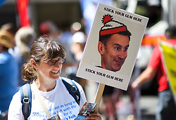 © Licensed to London News Pictures. 30/06/2018. London, UK. A woman carries a placard depicting Health Secretary Jeremy hunt as thousands of people take part in a march through central London to mark the 70th anniversary of the NHS. The UK's National Health Service was launched on July 5th, 1948 as part of major social reforms following the Second World War. Photo credit: Ben Cawthra/LNP