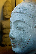 Stone head sculpture at the Male' Museum shows early Buddhist influence, prior to the archipelago being converted to Islam in the twelfth century.
