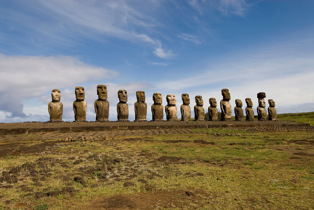 Chile, Easter Island: Array of statues or moai on a platform or ahu at Ahu Tongariki, near the quarry Rano Raruku.  This is the largest array of moia on Easter Island, consisting of 15 moai..Photo #: ch250-33846.Photo copyright Lee Foster www.fostertravel.com lee@fostertravel.com 510-549-2202