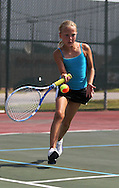 Grace O'Donnell, 8, of Cedar Rapids runs up on the ball during a Girls' 10 Singles match at the 2011 Baird Iowa Open tennis tournament at Westfield Tennis Club in Cedar Rapids on Wednesday, July 27, 2011. Over 200 players from Colorado, Illinois, Iowa, and South Dakota, participated in the event.