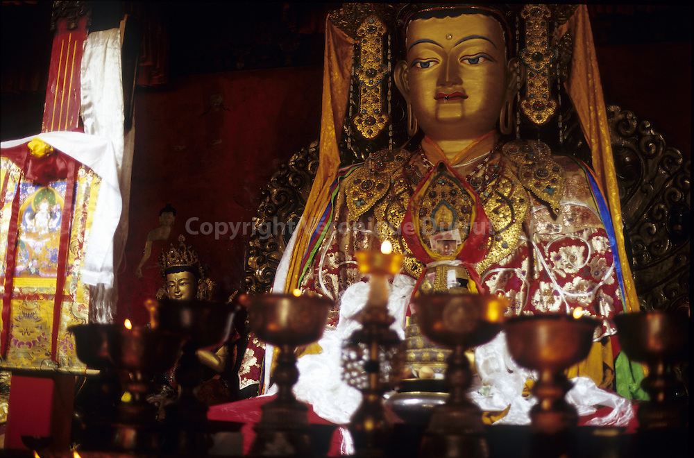 BUDDHA STATUE WITH YAK BUTTER LAMPS AS OFFERINGS, JAMPA LAKHANG TEMPLE, LHASA, TIBET