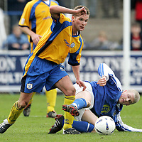 Queen of the South v St Johnstone...16.10.04<br />Jordan Tait wins this challenge with Willie Gibson<br /><br />Picture by Graeme Hart.<br />Copyright Perthshire Picture Agency<br />Tel: 01738 623350  Mobile: 07990 594431