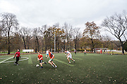 A group of men practice soccer at Park Lazienki in Warsaw, Poland