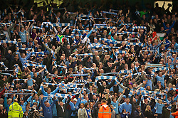 MANCHESTER, ENGLAND - Monday, April 30, 2012: Manchester City's supporters celebrate their 1-0 victory over rivals Manchester United during the Premiership match at the City of Manchester Stadium. (Pic by David Rawcliffe/Propaganda)