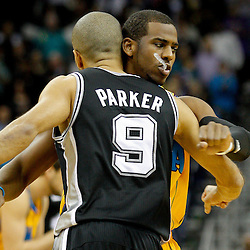 January 22, 2011; New Orleans, LA, USA; New Orleans Hornets point guard Chris Paul (3) and San Antonio Spurs point guard Tony Parker (9) greet each other prior to tip off of a game at the New Orleans Arena.   Mandatory Credit: Derick E. Hingle