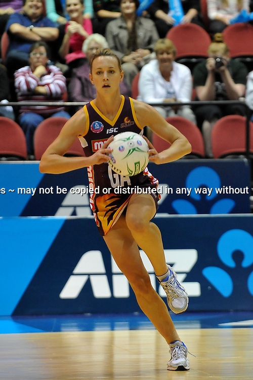 Natalie Medhurst looks to pass for the Firebirds during action from the Major Semi Final of the ANZ Netball Championship played between the Firebirds and the Magic at the Gold Coast Convention and Exhibition Centre on Monday 9th May 2011