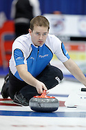 Reid Carruthers, second on Jeff Stoughton's team throws his rock in the team's first draw Wednesday.  The 2011 GP Car and Home Players' Championship ran April 12-17 at the Crystal Centre, Grande Prairie, AB..11-04-13, Photo Randy Vanderveen, Grande Prairie, Alberta.
