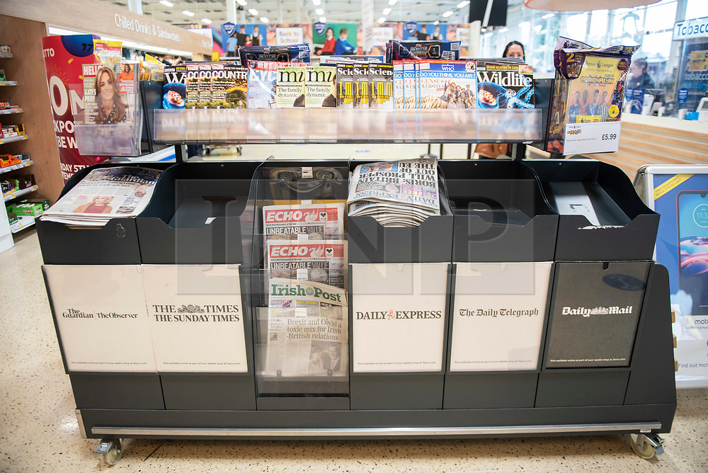 © Licensed to London News Pictures. 05/09/2020. Haydock, UK. A news stand sits half empty in a Tesco store in Haydock due to Extinction Rebellion blockades of the print plant. Photo credit: Kerry Elsworth/LNP