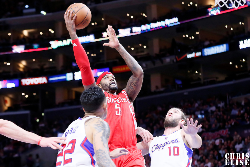 11 February 2015: Houston Rockets forward Josh Smith (5) goes for the layup over Los Angeles Clippers forward Spencer Hawes (10) during the Los Angeles Clippers 110-95 victory over the Houston Rockets, at the Staples Center, Los Angeles, California, USA.