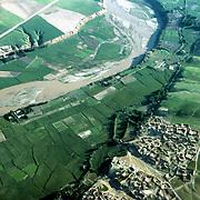 3 June 1976 <br /> Fields outside Taloqan. River. Trees lining jui (irrigation canal). Road.
