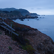 The shores of big sur are seen in the early evening.