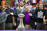 FORT WORTH, TX - JANUARY 19:  TCU football head coach Gary Patterson and his team present the Chick-fil-A Peach Bowl trophy during halftime against the Texas Longhorns on January 19, 2015 at Wilkerson-Greines AC in Fort Worth, Texas. (Photo by Cooper Neill/Getty Images) *** Local Caption *** Gary Patterson