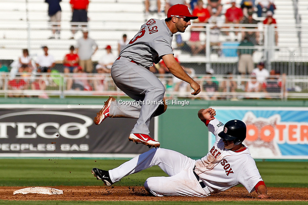 March 15, 2012; Fort Myers, FL, USA; Boston Red Sox right fielder Alex Hassan (82) is forced out by St. Louis Cardinals second baseman Daniel Descalso (33) during the bottom of the seventh inning of a spring training game at Jet Blue Park. Mandatory Credit: Derick E. Hingle-US PRESSWIRE