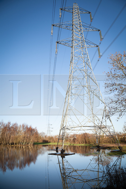 © Licensed to London News Pictures. 02/01/2014. River Blackwater, Hampshire, UK. Flooding in fields along the River Blackwater near to Wellow Mill near Romsey in Hampshire, UK. River levels are high following a night of wet and windy weather. More wet and windy weather is forecast. Photo credit : Rob Arnold/LNP
