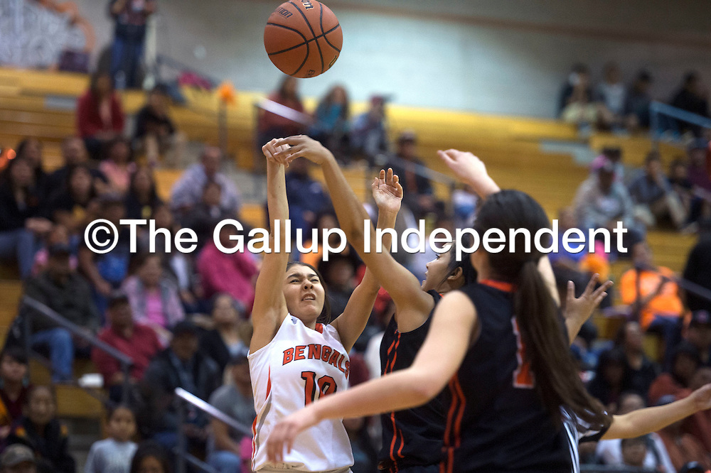 Gallup Bengal Paige Juan (10) attempts a three point shot against Aztec Tuesday in Gallup.