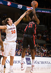 Georgia forward Porsha Phillips (21) shoots over Virginia forward Chelsea Shine (50).  The #15 ranked Virginia Cavaliers defeated the Georgia Lady Bulldogs 62-60 in NCAA Women's Basketball at the John Paul Jones Arena on the Grounds of the University of Virginia in Charlottesville, VA on January 2, 2009.