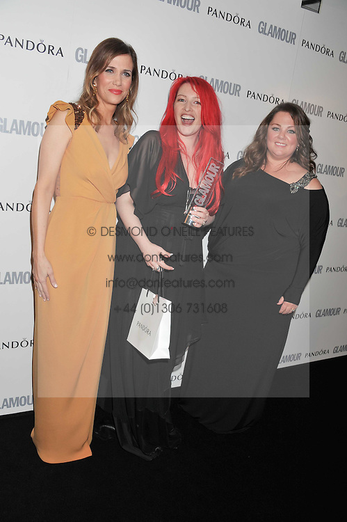 Left to right, KRISTEN WIIG, JANE GOLDMAN and MELISSA McCARTHY at the Glamour Women of The Year Awards 2011 held in Berkeley Square, London W1 on 7th June 2011.