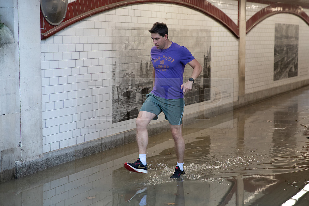 © Licensed to London News Pictures. 30/09/2019. London, UK. A pedestrian negotiates a large area of water caused by flooding under a bridge near Blackfriars in Central London. Heavy rainfall is forecast for early this week. Photo credit : Tom Nicholson/LNP