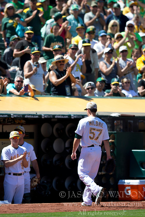OAKLAND, CA - MAY 26:  Tommy Milone #57 of the Oakland Athletics returns to the dugout after being relieved against the Detroit Tigers during the seventh inning at O.co Coliseum on May 26, 2014 in Oakland, California. (Photo by Jason O. Watson/Getty Images) *** Local Caption *** Tommy Milone
